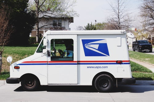 usps-truck-stopped-on-street-in-neighborhood-mail-route